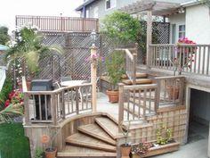 Multi level Redwood deck with spiral platform stairs.