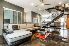 Contemporary Living Room with flush light, High ceiling, Ceiling fan, Knoll Barcelona Couch, Hardwood floors, Carpet