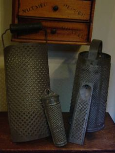 early antique punched tin graters.