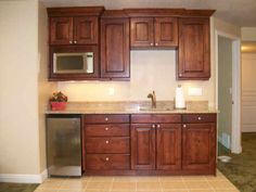 Basement apartment kitchenette - love the cupboards to the ceiling, built-in microwave. ~ just needs an island