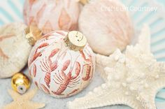 Create easy DIY coastal ornaments with just scrapbook paper and Mod Podge. My coastal Christmas this year is full of easy and inexpensive DIY ornaments!