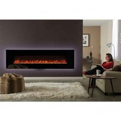 Browse full range of Electric fires and surrounds. Electric fires available with LED light and remote control. Electric Fire And Surround, Inset Electric Fires, Wall Mounted Electric Fires, Wall Fires, Beautiful Wall, Stove, Lounge, Led, Fireplaces