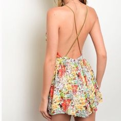 New floral open back romper with chain straps Flowing floral open back with gold strap romper. This runs a full size small, I recommend ordering a size up Pants Jumpsuits & Rompers