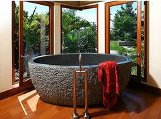 This is a granite soaking tub and it weighs one ton. I don't see a ladder. I would need a ladder.