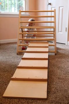 The Pikler Triangle is a childhood development climbing structure based on the RIE method. It helps develop confidence, curiosity, and Reggio Emilia, Indoor Activities For Kids, Infant Activities, Children Activities, Montessori Activities, Painting Plastic Chairs, Baby Cribs For Twins, Toy Storage Bench, Toys For 1 Year Old