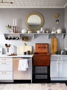 Kitchen with eclectic decorative accents and shelving