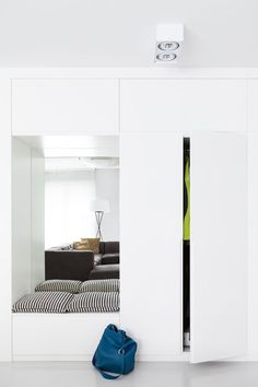 I love this modern and airy mudroom solution