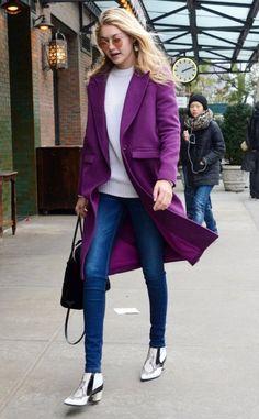 Gigi Hadid loves a splash of purple as she walks the streets of New York