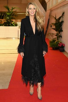 11 May Blake Lively looked chic in a black feathered dress and coat for the Opening Night Gala Dinner.   - HarpersBAZAAR.co.uk