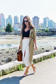Trench coat, cropped top, side slit skirt, all by @aritzia .