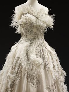 Evening dress (image 2) | Pierre Balmain | 1950-55 | French; Paris | Embroidered silk organza trimmed with sequins, rhinestones and ostrich feathers, boned, supported by silk, nylon and tulle, metal | Victoria & Albert Museum | Museum No.: T.176-1969