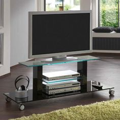 Opus Gloss Black TV Trolley, 80130 £159.95 Dimensions:  W130cm x D50cm x H48cm