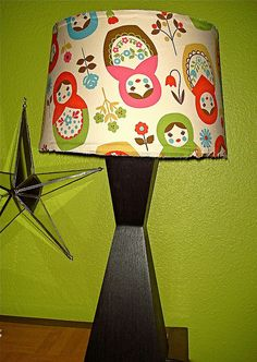 i recovered a boring lamp shade with cute fabric.
