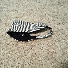 Reversible lululemon bang buster Worn only once Reversible lululemon bang buster. Perfect to keep sweat out of the eyes!!! Black on 1 side, black and white stripes on the other lululemon athletica Accessories Hair Accessories