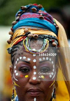 News Photo: woman presents an Afro Colombian hairstyle during the…