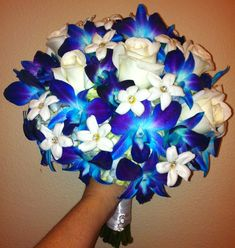 blue orchid and white rose wedding bouquet. I am in LOVE with this bouquet. blue orchid and white rose wedding bouquet. I am in LOVE with this bouquet. White Roses Wedding, Rose Wedding Bouquet, Purple Wedding, Floral Wedding, Wedding Flowers, Rose Bouquet, Bridal Bouquet Blue, Orchid Bouquet, Bridesmaid Bouquet