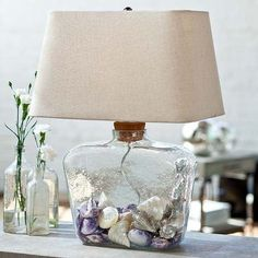 Interior HomeScapes offers the Cork-Top, Fill-able Glass Shoulder Lamp by Regina Andrew Design. Visit our online store to order your Regina Andrew Design products today. Fillable Lamp, Shell Lamp, Deco Marine, Tiffany Lamps, Unique Lamps, Jar Lamp, Beach House Decor, Glass Table, Beach Themes