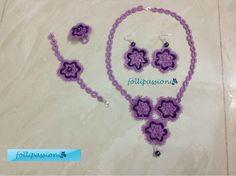 Set composto da anello, orecchini, bracciale e collana  viola e lamè