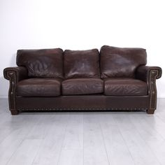 Roma Leather Sofa. - Elegant brown leather three-seat couch- Light wear associated with normal use- Seat height: 18""