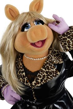 Who rocks leopard print trim better, Miss Piggy or Avril Lavigne?   Who Wore It Better: Miss Piggy Or These Celebrities?