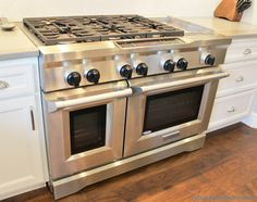 Attrayant White Painted Kitchen In A Coal Valley, IL With 48 Inch KitchenAid Gas Range .