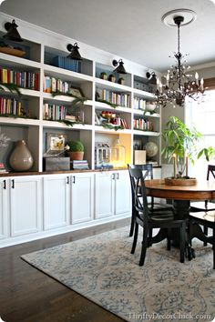 DIY bookcases - another dining room to library conversion. This would totally work in my dining room!
