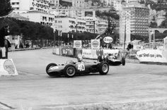 1962: Belgian racing driver Willy Mairesse leads Graham Hill at Monaco....
