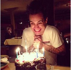 Looks like he's plotting something evil with that cake.  #panic! At the disco #brendon urie:
