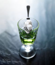 absinthe in pontarlier glass with spoon and sugar cubes by JoshuaResnick