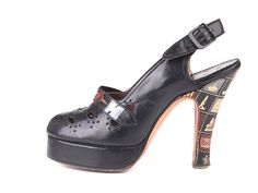 1940s black leather peep-toe platform shoes with, decorated with gilded images of touristic attraction on the heels and vamp. WANT SO MUCH.