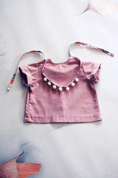 Fleur & Dot. I thought this was a bib and shirt duo...idea to make bib and matching shirt  sets