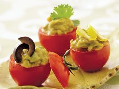 Avocado Stuffed Cherry Tomatoes  I am trying this next!!