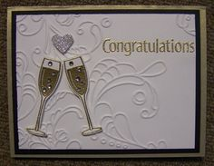 Embellished Events. Wedding card with champagne glasses