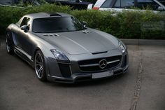 Matte Grey Mercedes SLS.    Needs to delete the roof intake-there's no need for it.  But otherwise a nicely done SLS