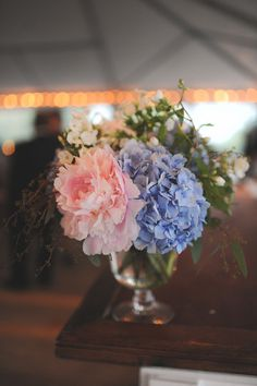 Pink peony and blue hydrangea wedding centerpiece in silver vessel {Brit Perkins Photography}