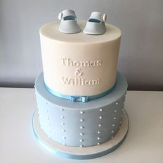 Boys blue and white christening cake, clean elegant lines with sugar booties.