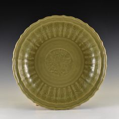 A FINE LARGE CHINESE CARVED 'PEONY' LONGQUAN CELADON BARBED-RIM CHARGER
