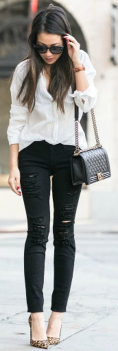 A monochrome look + pair of ripped black jeans + Wendy Nguyen + ultra edgy + simplistic outfit + white shirt + ripped jeans + statement leopard print heels   Top: Nili Lotan, Jeans: Frame, Bag: Chanel, Shoes: Christian Louboutin.