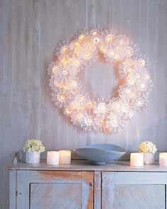 I love this lace wreath! All you have to do is fashion some wire in a circular form, intertwine white string lights, and then attach doilies to the frame with string or glue! Not sure how it would fit in with the room but might be good as a photo frame.