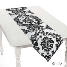 An intricate flocked design gives this table runner a stunning look for any wedding reception, banquet table, Christmas or other holiday party. The runner . Hollywood Glamour Party, Banquet Tables, Oriental Trading, Halloween Crafts, Holiday Parties, Table Runners, Wedding Reception, Black And White, Place Mats