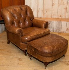 Tufted leather club chair with matching ottoman on casters. From Hickory Chair. Loden green leather is worn in areas, but in decent condition.