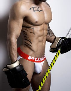 Hockey Jock by PUMP  • White Ribbed Nylon/Cotton Blend.  • Red Stitch Accent on Cup  • Blue piping on Cup  • Wide Red Elastic Wasitband