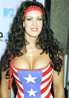 Wrestling personality Chyna poses for photographers September 7, 2000 at the 2000 MTV Video Music Awards at Radio City Music Hall in New York City. (Photo by George DeSota/Liaison)