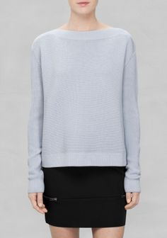 This ribbed boat neck knit has long sleeves and a straight, slightly boxy, fit.