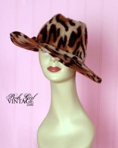 1970's Leopard Fur Print Fedora Hat  Seriously cool and hippie chic! JLo would wear this in a heart beat. The fabric is not labeled but it is super soft almost like it has angora fur or something in it...vicuna? Very well made designer rich hippie style & quality. Wire around rim to shape any way you want. There's a band and bow around the head & it is not flat on the top it has that cool indent like the old hats from the 40's men wore.