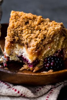 Soft and buttery blackberry crumb cake with cream cheese filling and brown sugar cinnamon streusel! Recipe on sallysbakingaddiction.com