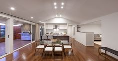 Raised ceilings, bamboo floors, open spaces and a seamless connection to the outdoors make this open plan living space an enviable feature of the home | Sekisui House #homedesign #interiordecorating #livingarea #dining #decor