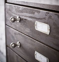 New knobs and label plates have been placed on an IKEA RAST 3 drawer chest.