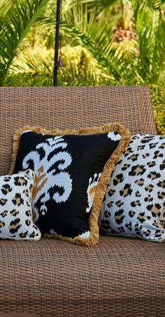 Our richly colored Kasuri Onyx Outdoor Pillow features a large centered medallion and is expertly embellished with lovely Bamboo fringe.  | Frontgate: Live Beautifully Outdoors