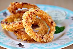 Oven Fried Onion Rings by zoomyummy: Made with a potato chip coating which is full of spicy flavor, these are crunchy around, soft and sweet in the middle. #Onion_Rings #Oven_Fried